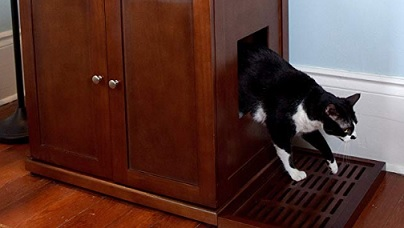 cat walking out of cat litter box furniture